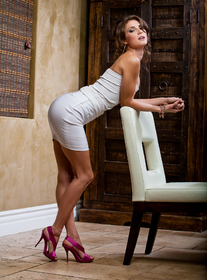 Jenni Lee in a tight white dress and pink high heels getting ready to fuck her boyfriends son